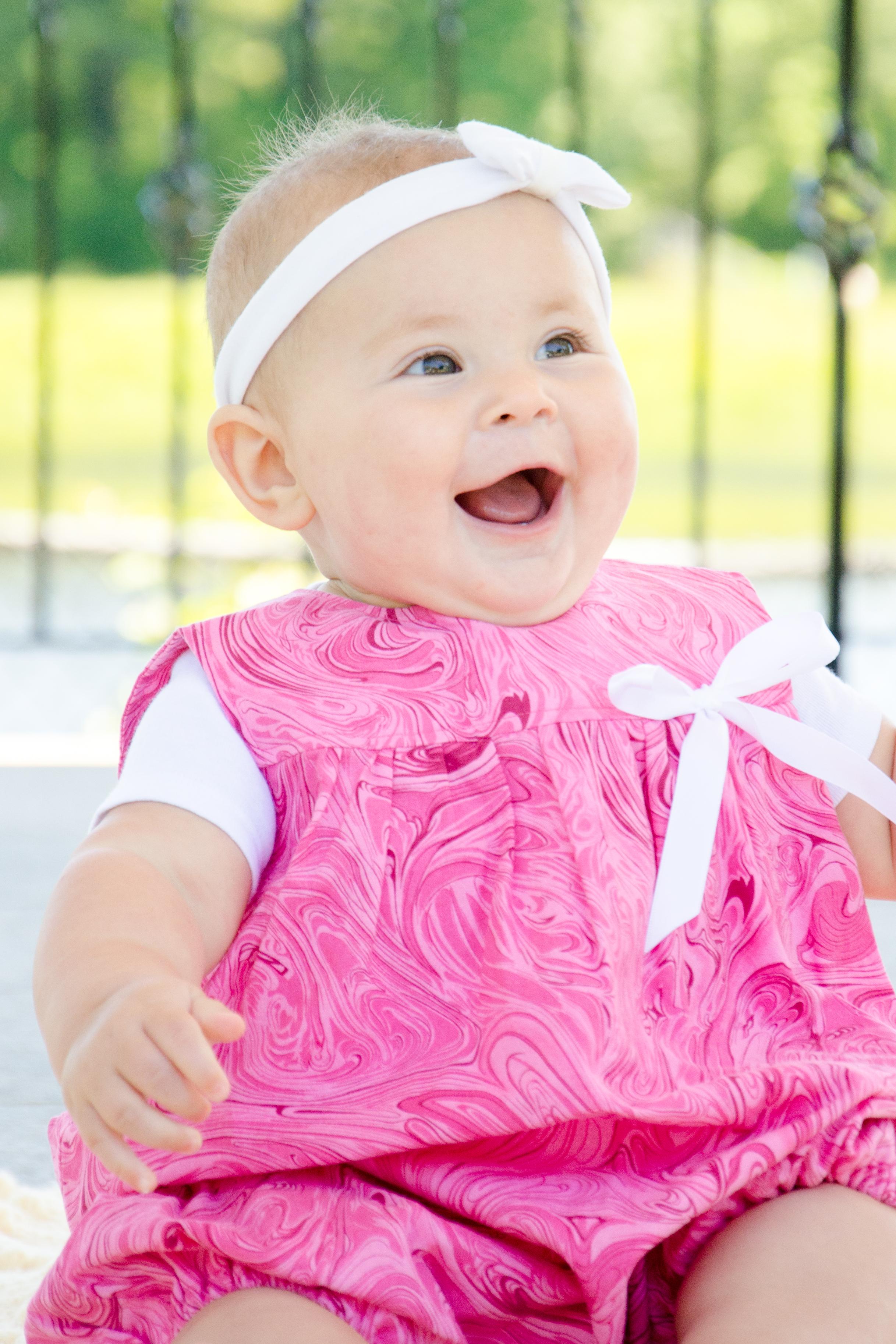 Adelina in a pink swirl bubble romper