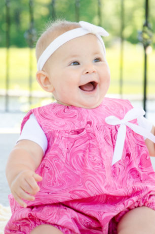 Adelina in a pink swirl bubble romper